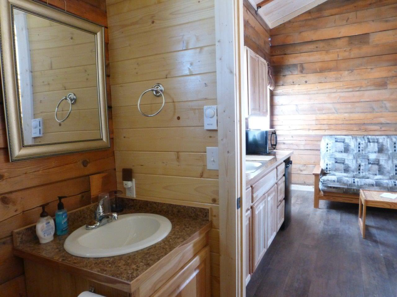 Inside Sperry cabin with washroom and kitchen.